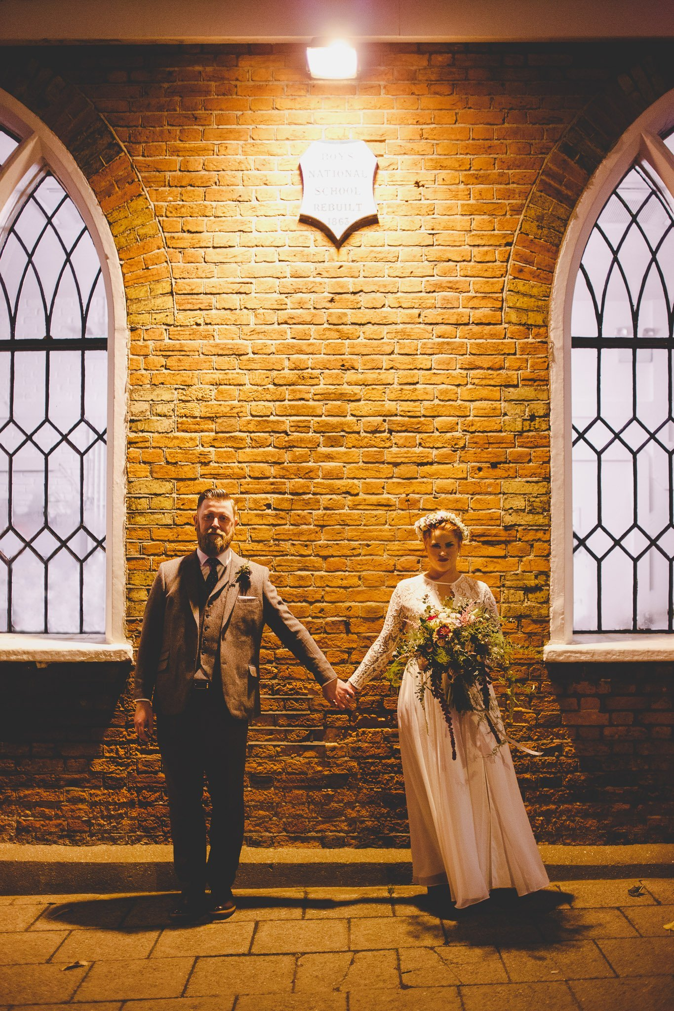 Vintage dressed bride and groom outside The Old Parish Rooms Essex at night under a spotlight. Photography by thatthingyoupluck.